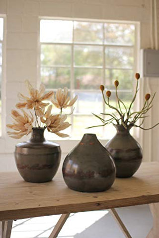 Set Of Three Metal Vases Above Raw Metal With Copper Detail