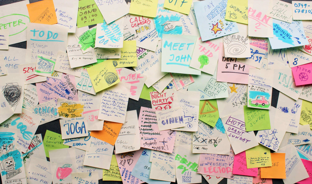 A personal freedom wall of sticky notes that have written reminders
