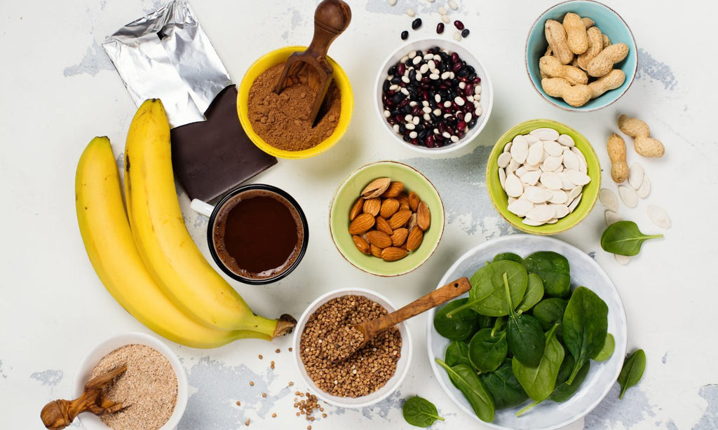 Nine Minerals from different food - banana, chocolate, quinoa seeds, peanuts, almond, pumpkin seeds,  flax seeds, hemp seeds,   spinach place in a white background