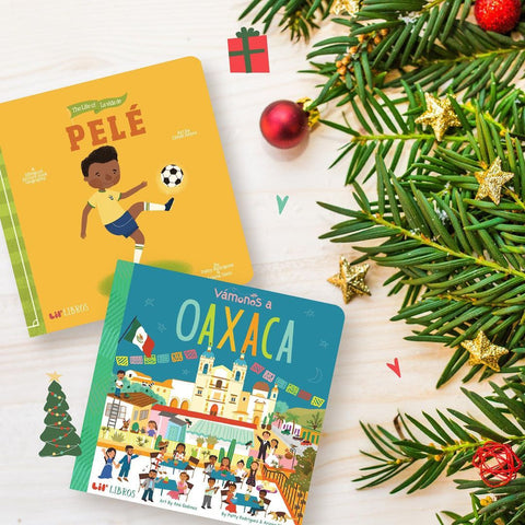 Bilingual (English/ Spanish) books under a Christmas tree