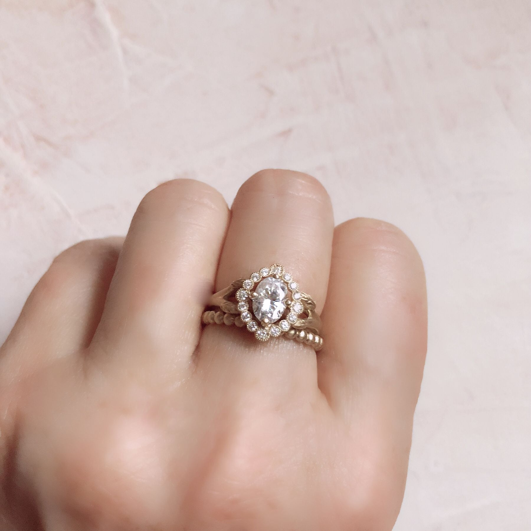 gold oval halo engagement ring