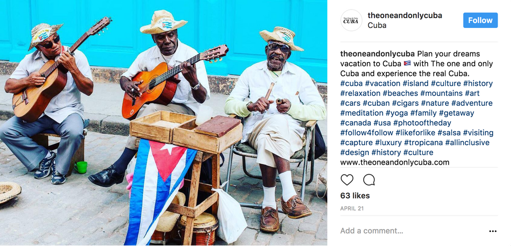 Cuban men playing music on the street with a bright turquoise background