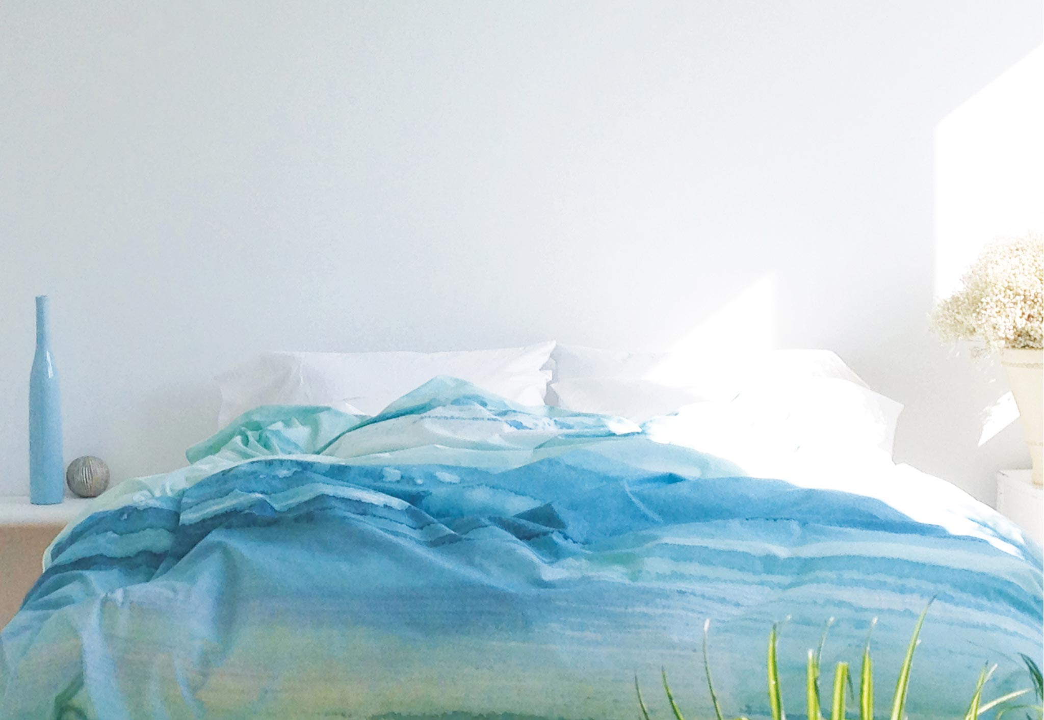 ZayZay Living Paradisus duvet cover ocean aqua colour on bed in bright bedroom