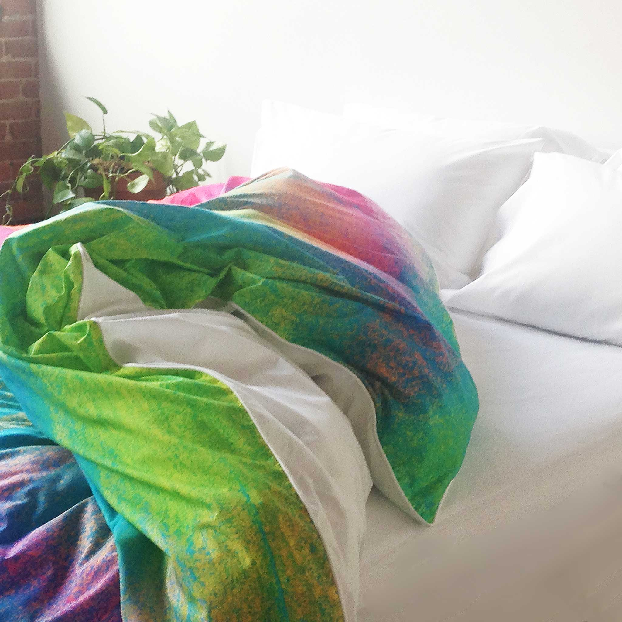 ZayZay luxury linen duvet cover Tropical Frost design bright colours tossed open on bed