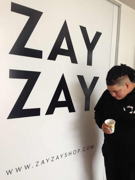 Vanessa Lockwood with ZayZay Logo
