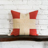 Bailee Coral Woven Pillow Against Brick Background
