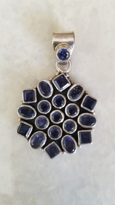 Handcrafted silver pendant studded with semi precious Amethyst stones