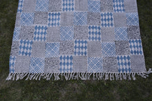 INDIGO DYED HANDWOVEN BLOCK PRINTED COTTON RUG WITH FLORAL DESIGN