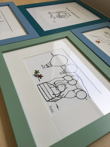 Multiple framed cat art