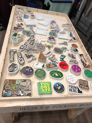 Sticker Table THEN - CDA Idaho Clothing Co.