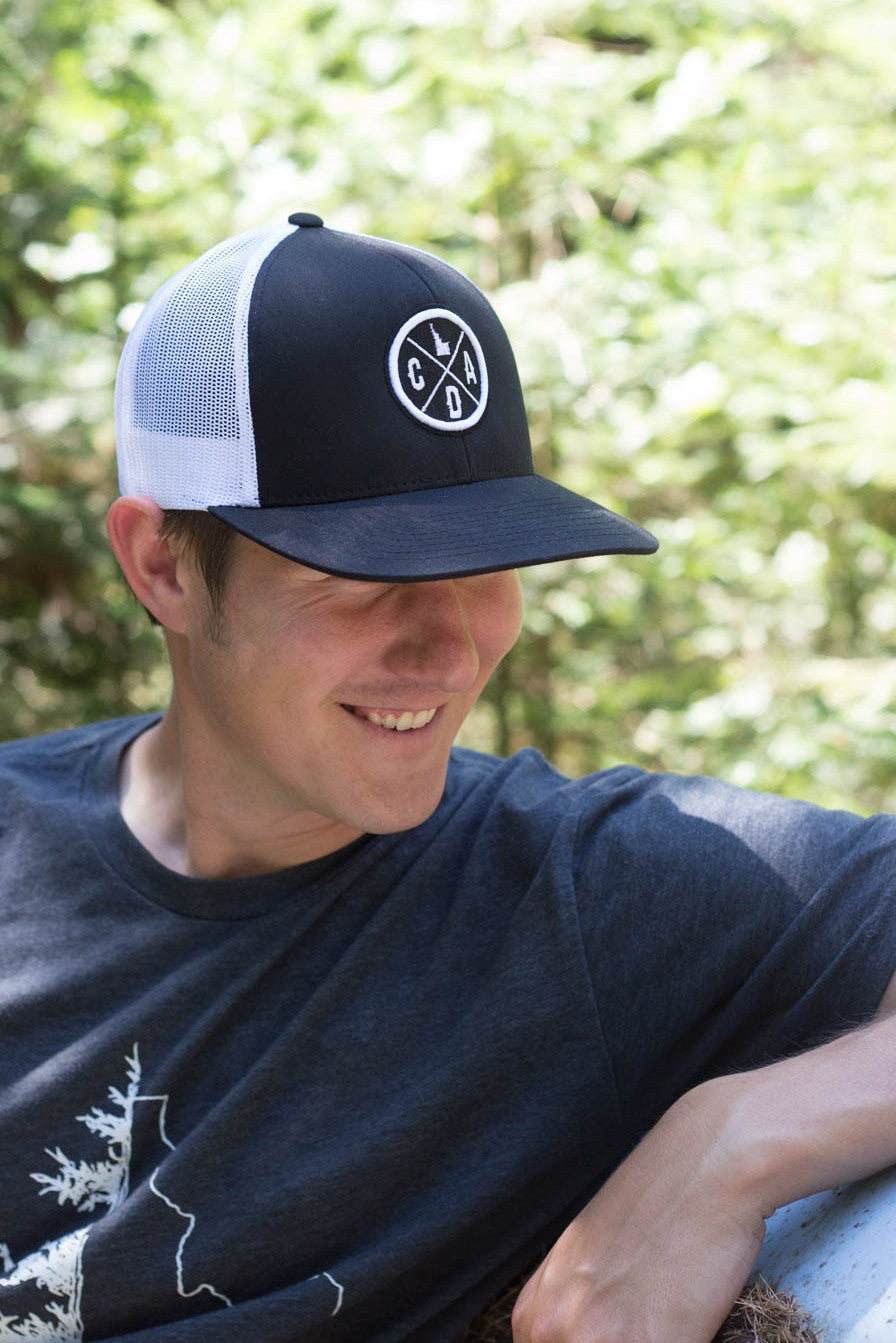 Embroidered CDA IDAHO Logo Trucker Hat- Black & White