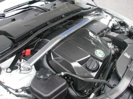 Racing Dynamics Carbon Fiber Engine Cover for BMW models with N55 motors including BMW 135i, X1, 335i, 335xi & 535i/xi