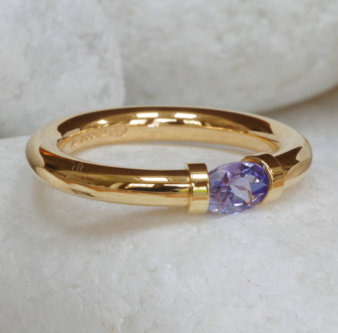 9 carat Gold Tension Ring set with a Tanzanite