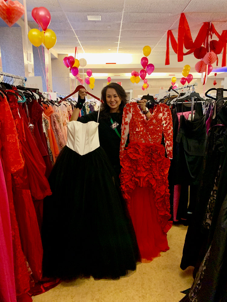 Stacey Chang Holding Donated Dresses