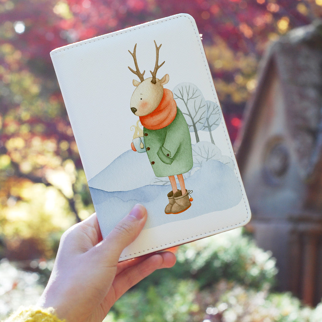 a girl holding personalized RFID blocking passport travel wallet with Winter Charm design