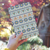 a girl holding personalized RFID blocking passport travel wallet with Tribal Patterns design