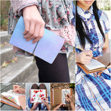 a young girl holding midori style traveler's notebook with ombre pastel galaxy design