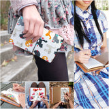 a young girl holding midori style traveler's notebook with playful pussycats design