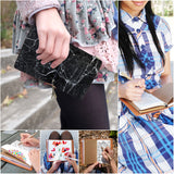 a young girl holding midori style traveler's notebook with moody marble design
