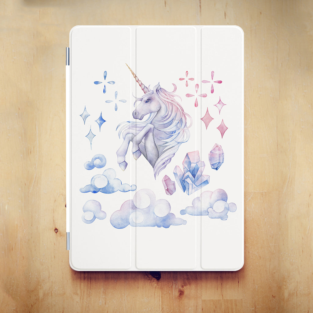 personalized iPad case smart cover with pastel ombre unicorn design on the wooden desk
