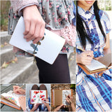 a young girl holding midori style traveler's notebook with boho feathers design