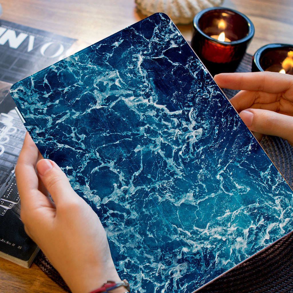 a girl holding personalized iPad case smart cover with ocean waves design