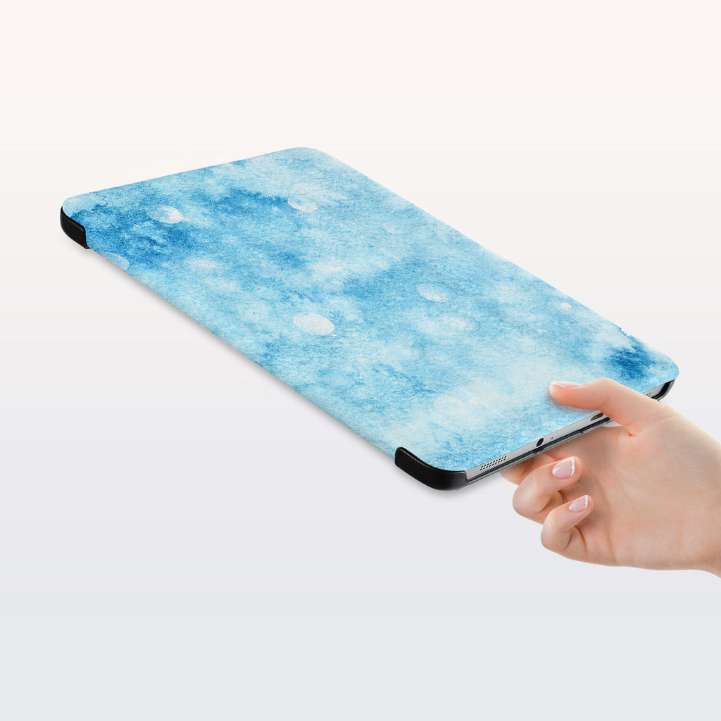 a hand is holding the Personalized Samsung Galaxy Tab Case with Winter design