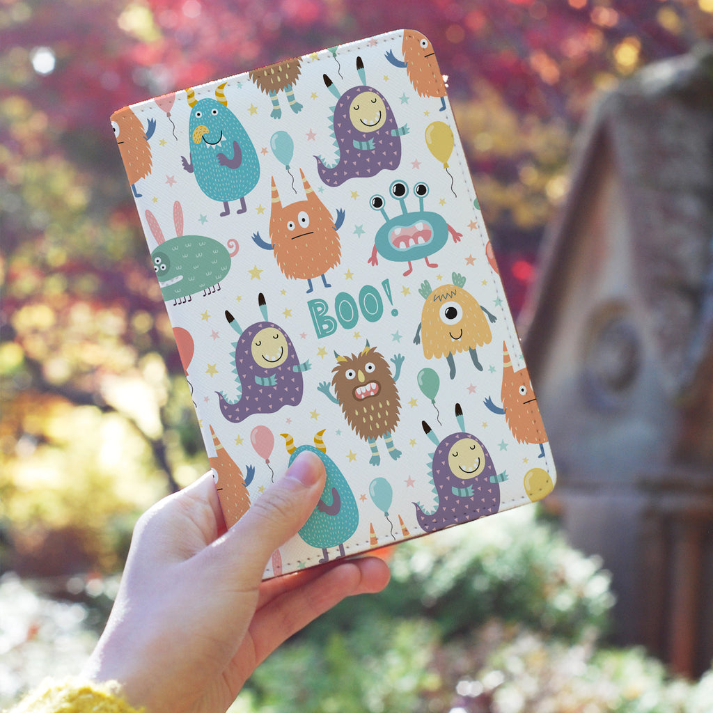 a girl holding personalized RFID blocking passport travel wallet with Boo design