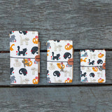 three sizes of midori style traveler's notebook with playful pussycats design on the wooden bench