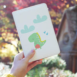 a girl holding personalized RFID blocking passport travel wallet with Dino design