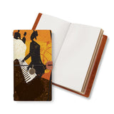 opened midori style traveler's notebook with Music design