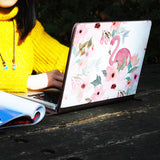 a girl using macbook air with personalized Macbook carry bag case with Flamingo design on a wooden table