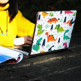 a girl using macbook air with personalized Macbook carry bag case with Dinosaur design on a wooden table