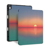front and back view of personalized iPad case with pencil holder and Sunset Clouds design