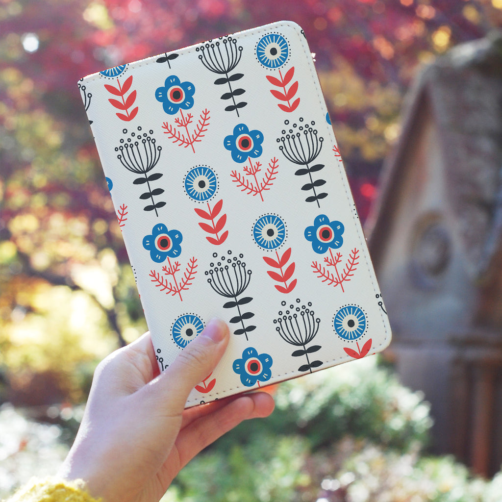 a girl holding personalized RFID blocking passport travel wallet with North Dream design