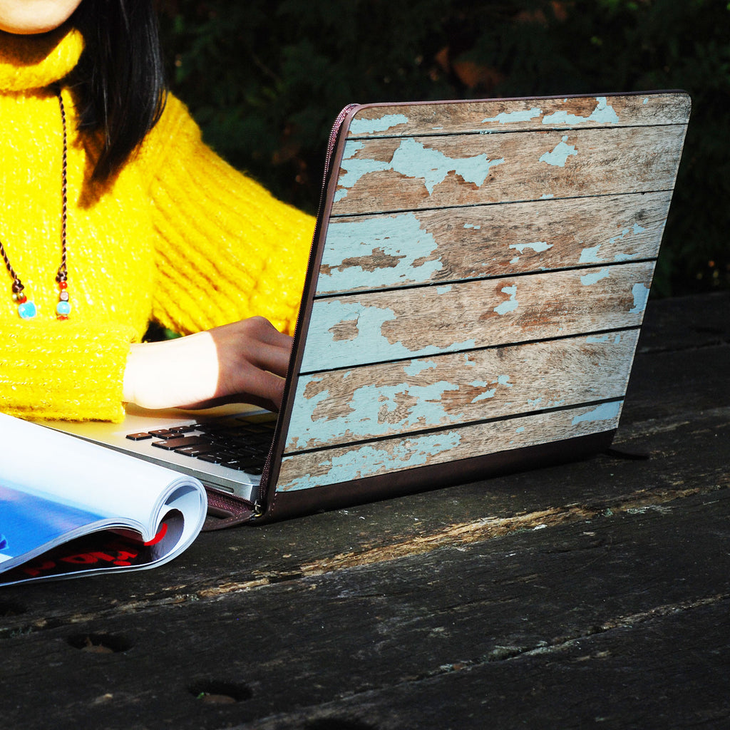 a girl using macbook air with personalized Macbook carry bag case with Wood design on a wooden table