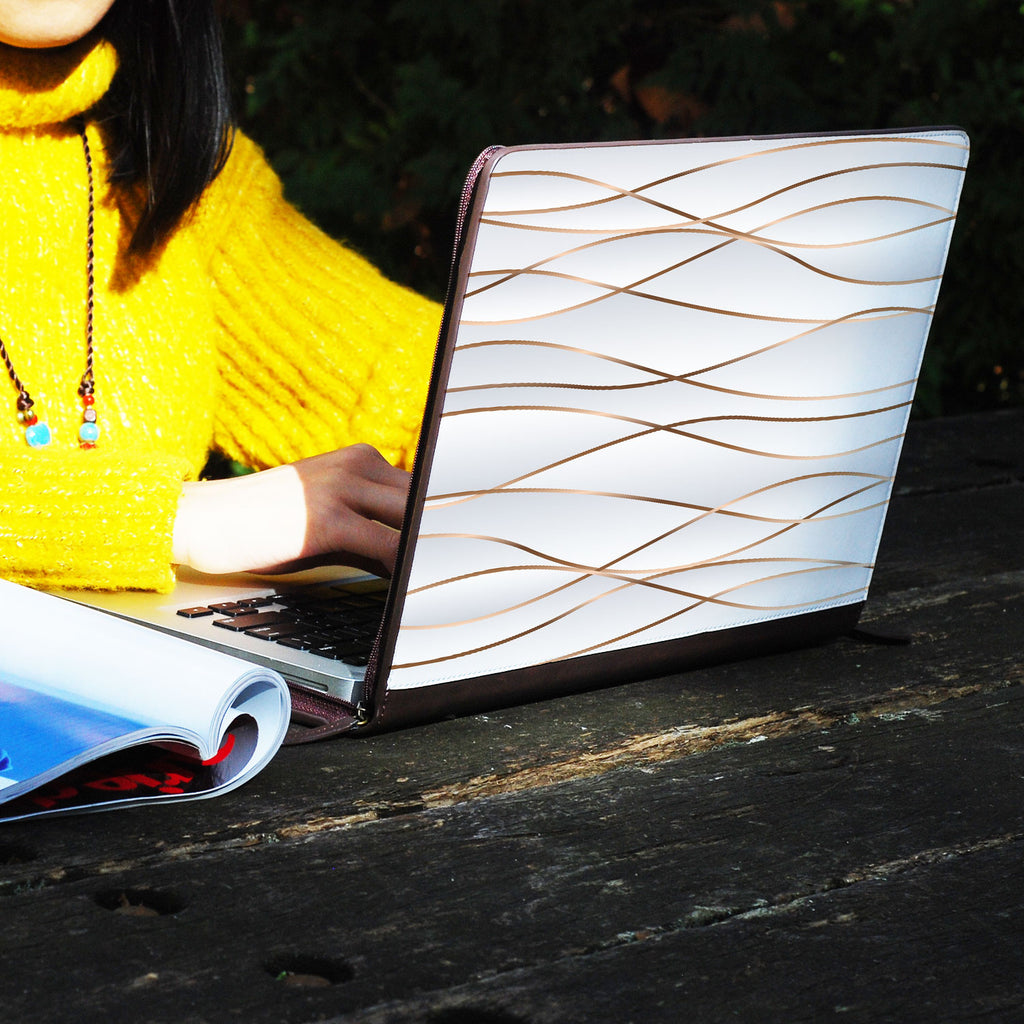 a girl using macbook air with personalized Macbook carry bag case with Luxury design on a wooden table