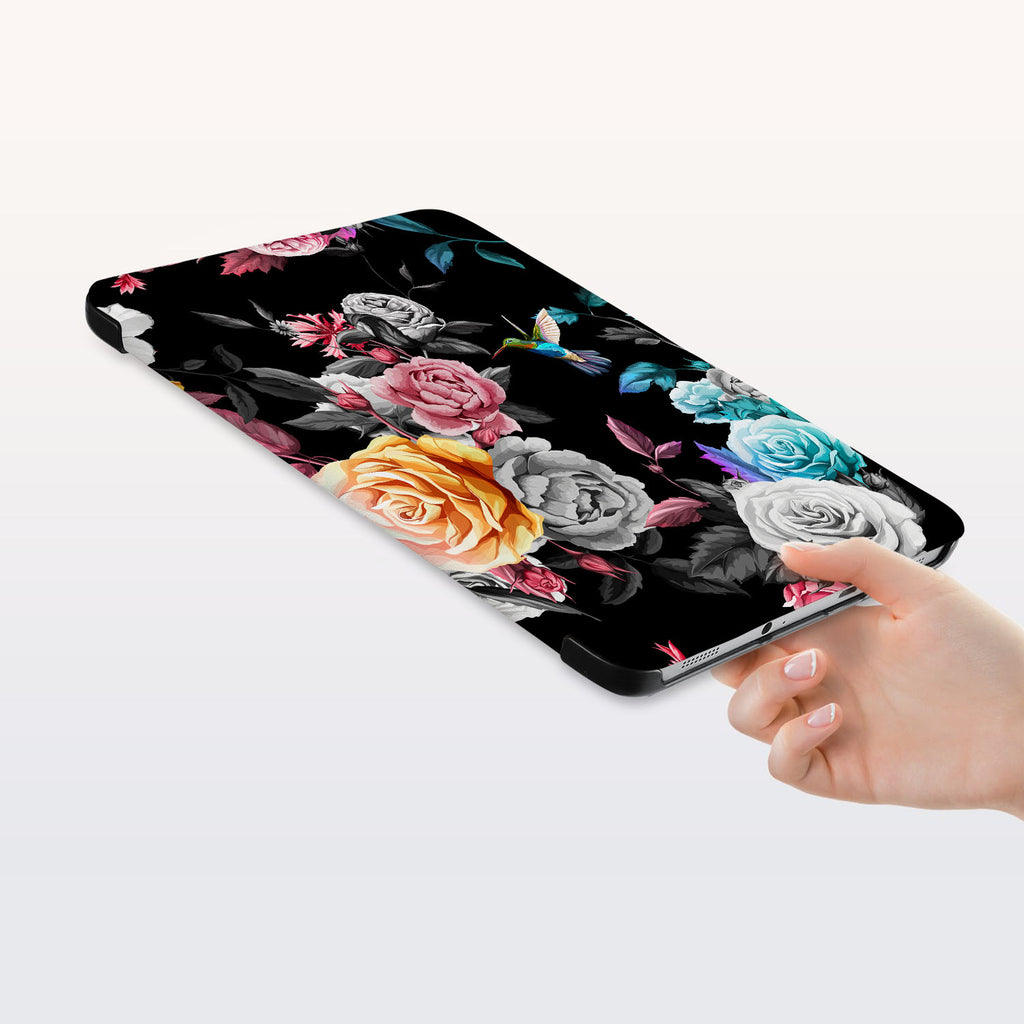 a hand is holding the Personalized Samsung Galaxy Tab Case with Black Flower design
