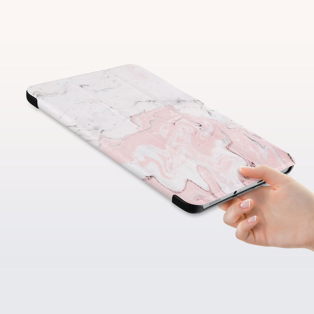 a hand is holding the Personalized Samsung Galaxy Tab Case with Pink Marble design