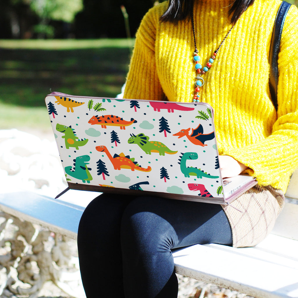 two hands holding personalized Macbook carry bag case with Dinosaur design swap