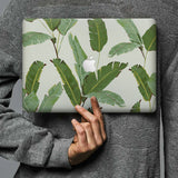 Form-fitting hardshell with Green Leaves design keeps scuffs and scratches at bay