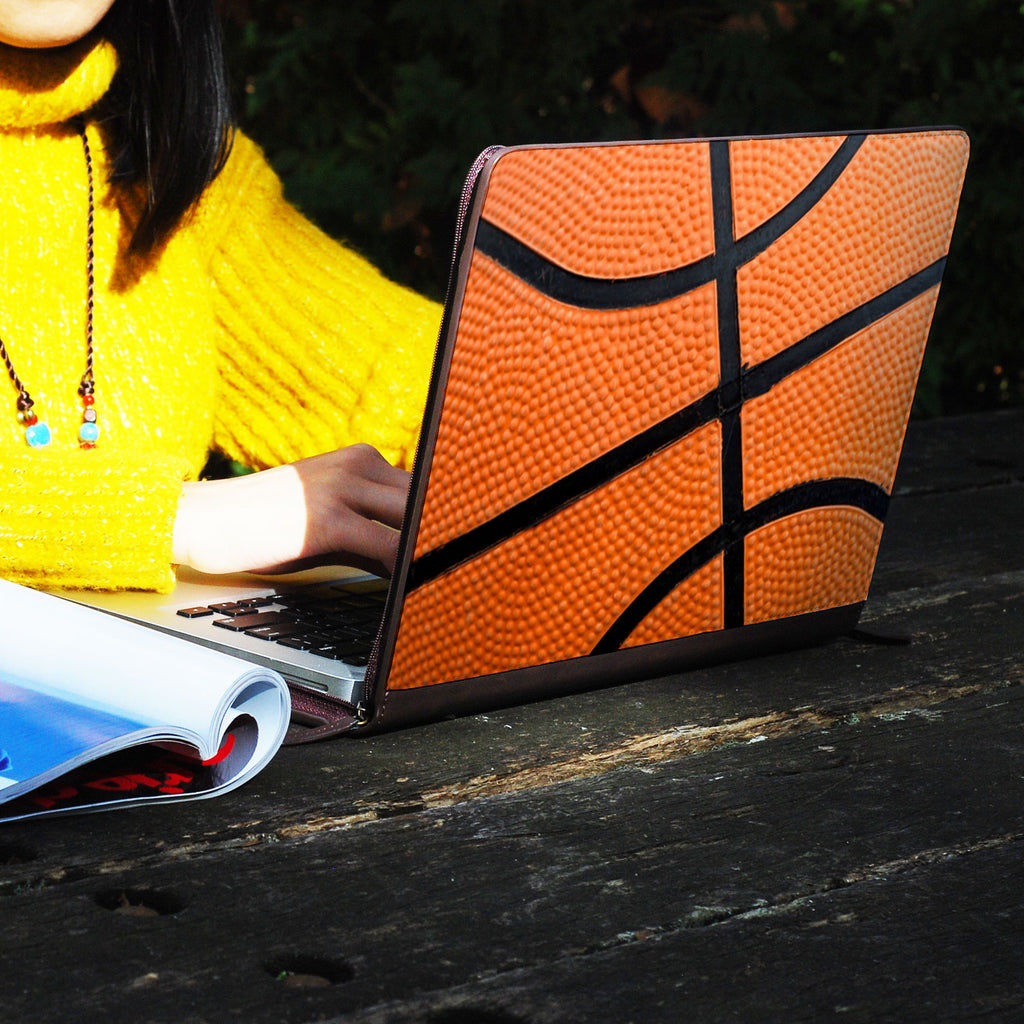 a girl using macbook air with personalized Macbook carry bag case with Sport design on a wooden table