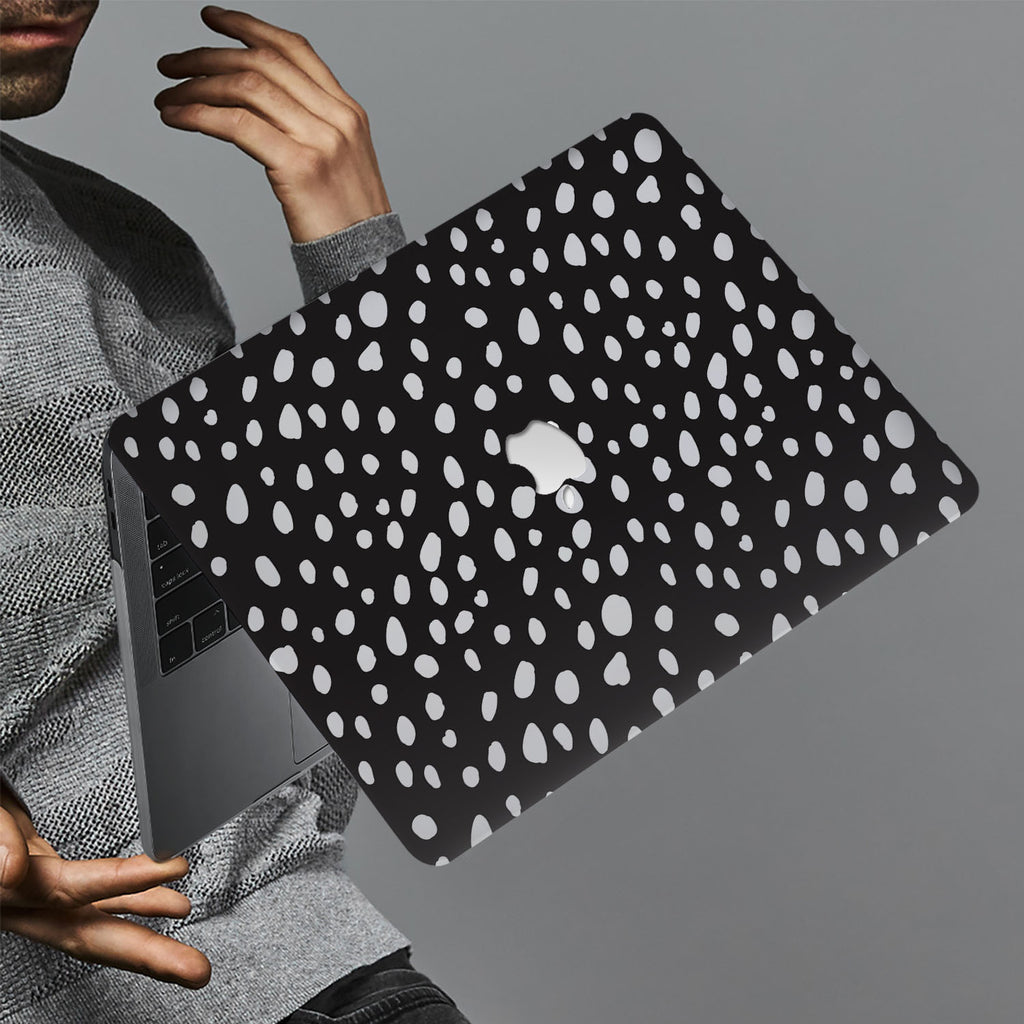 hardshell case with Polka Dot design holds up to scratches, punctures, and dents