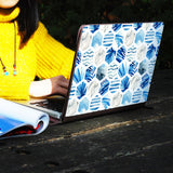 a girl using macbook air with personalized Macbook carry bag case with Geometric Flower design on a wooden table