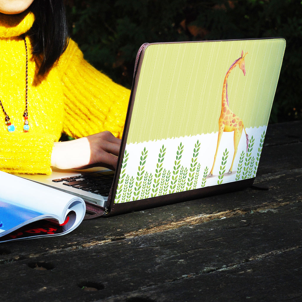 a girl using macbook air with personalized Macbook carry bag case with Cute Animal 2 design on a wooden table
