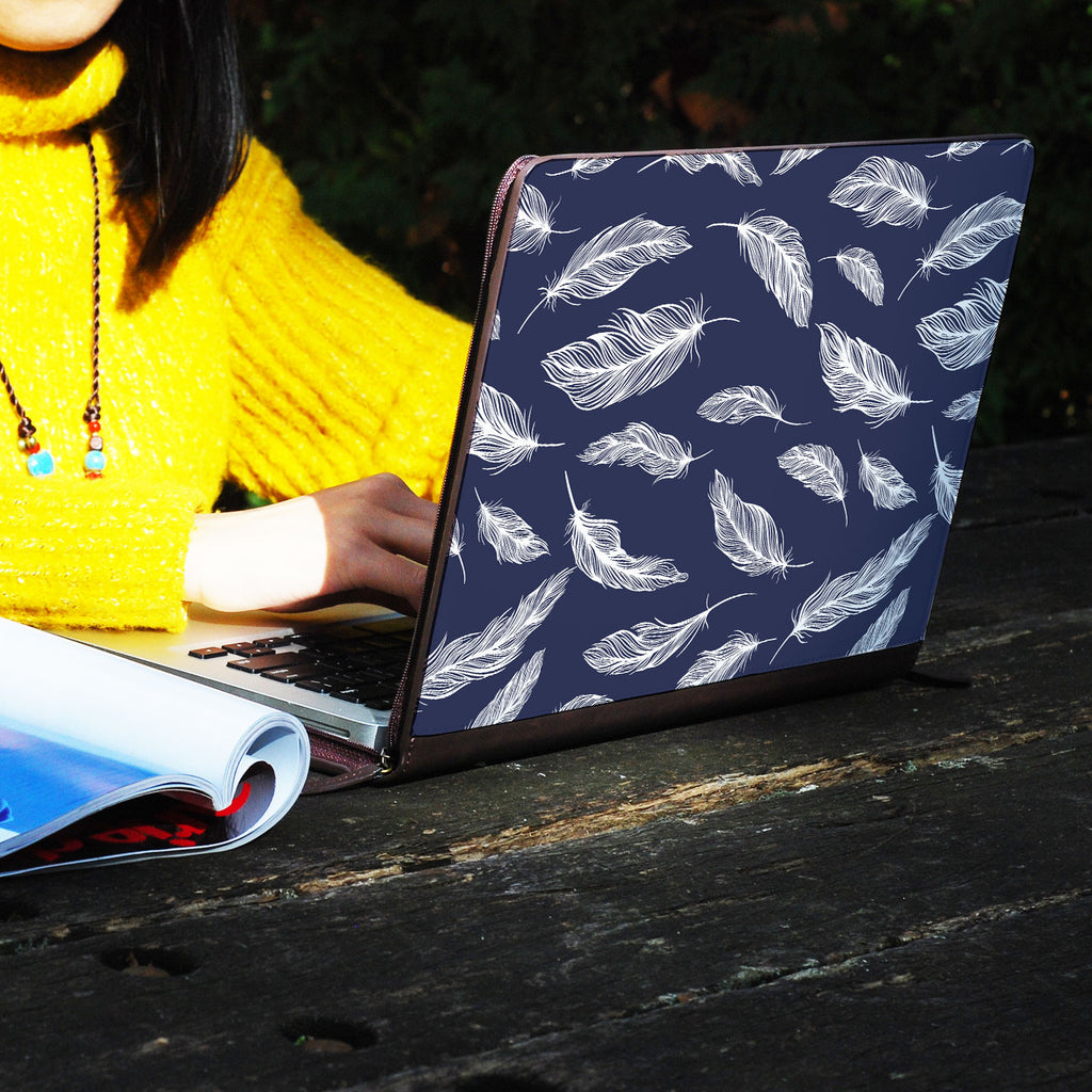 a girl using macbook air with personalized Macbook carry bag case with Feather design on a wooden table