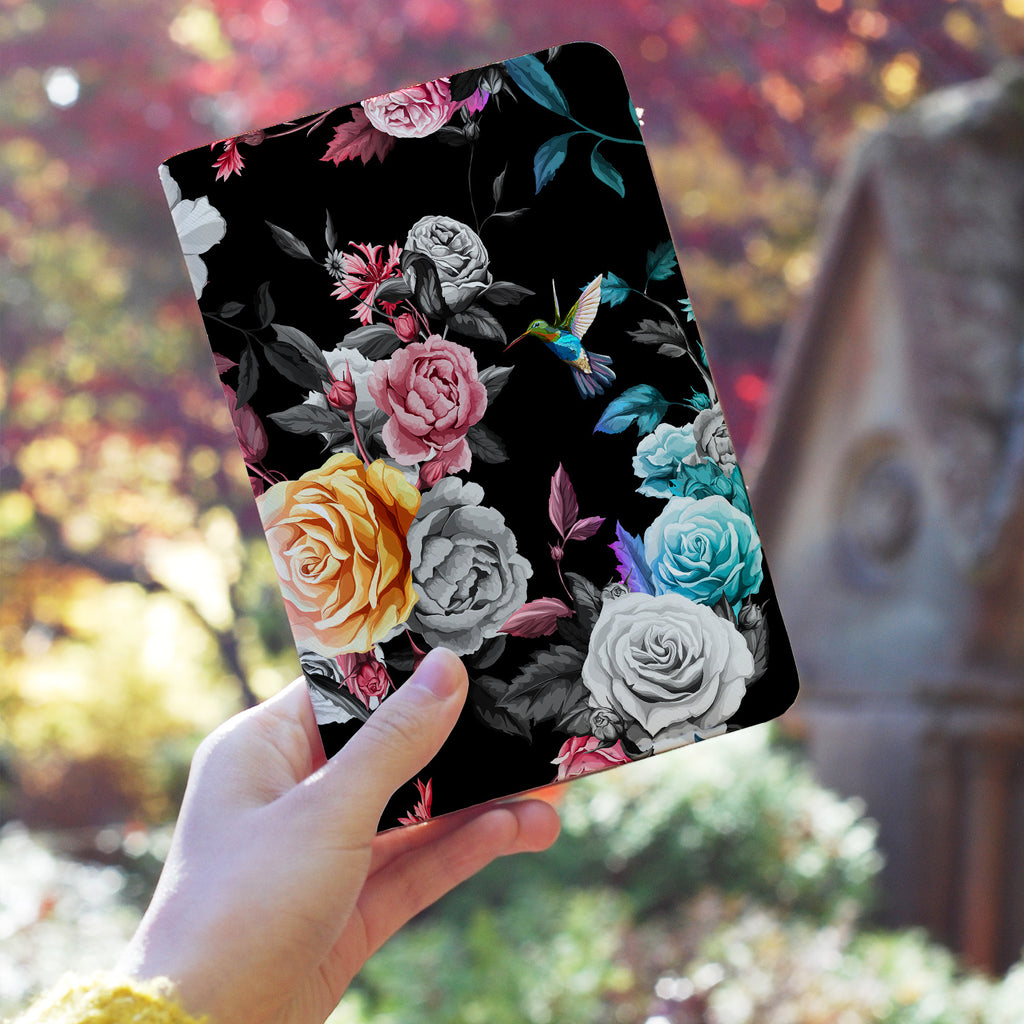 a girl holding personalized RFID blocking passport travel wallet with Black Flower design