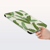 a hand is holding the Personalized Samsung Galaxy Tab Case with Green Leaves design