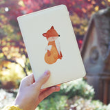 a girl holding personalized RFID blocking passport travel wallet with Autumn Treasure design