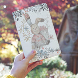 a girl holding personalized RFID blocking passport travel wallet with Fairy Rabbits design